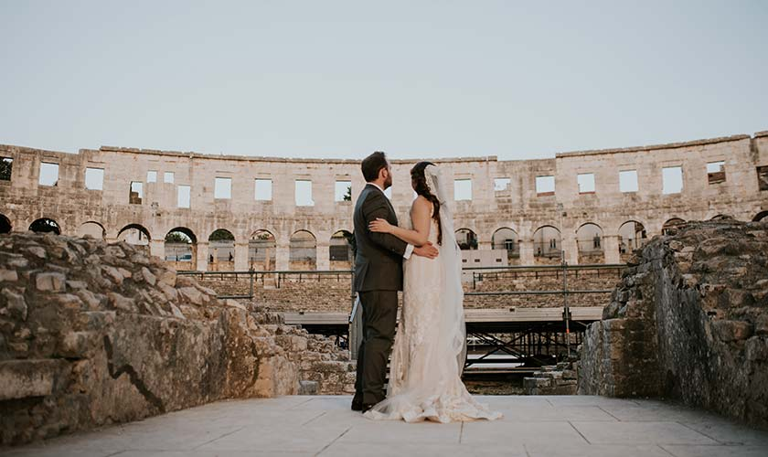 Newlyweds overlooking the Roman amphiteather Arena in Pula.